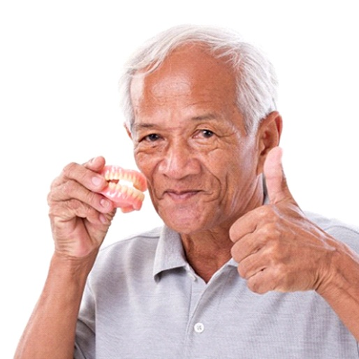 man gives thumbs up for denture sin Columbus